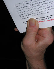 A person holding a piece of paper