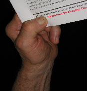 A person holding paper with their hand